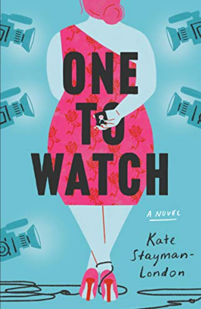 Book cover of One to Watch by Kate Stayman-London. Blue background with drawing of a woman's back. The woman is wearing a pink dress and heels and is holding a diamond ring behind her back. She is surrounded by video cameras.